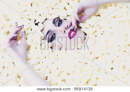 Fashionable Woman In Corn Sticks Heap