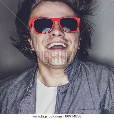 closeup portrait of a casual young man with sunglasses