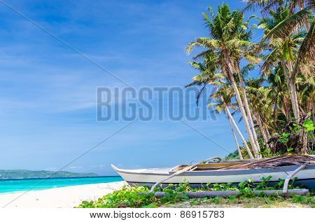 Tropical White Beach View And Lonely Sailboat Near Palm Trees And Turquoise Sea