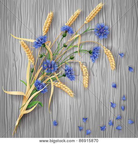 Cornflowers And Wheat Ears Bunch On Wood Background