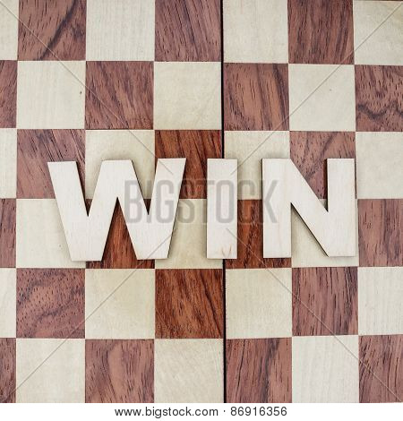 win concept on wooden background