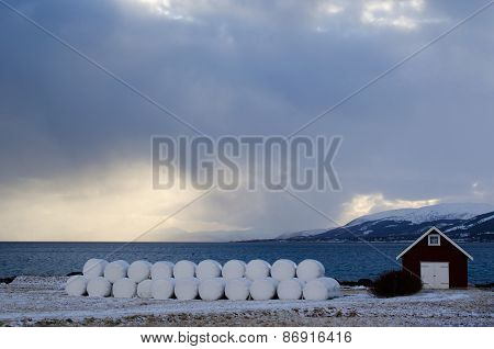 Stack of hay bales in North of Norway