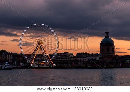 Toulouse Ferris Wheel And Hopital De La Grave At Sunset