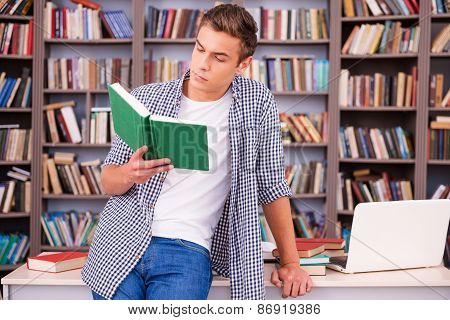 Reading His Favorite Book.