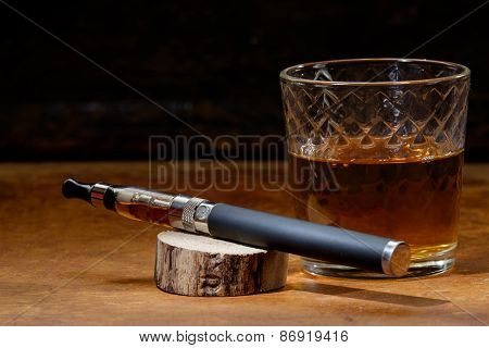 Vintage Still Life With E-cigarette And A Glass Of Bourbon