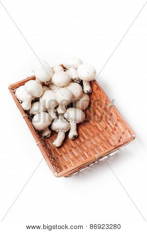 Basket With Bunch Of White Mushrooms White Background