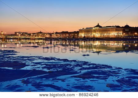 ST. PETERSBURG, RUSSIA - MARCH 17, 2015: Ice drift on Neva river against the building of Russian Academy of Arts. Built in 1789, now the building houses the Ilya Repin Institute for Painting