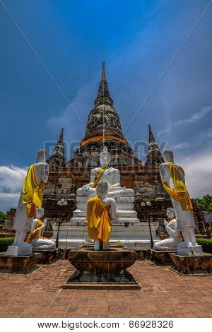 Ancient pagoda with white Buddha Image and 5 monks statue
