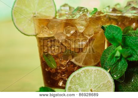 Drink Concept - Cocktail With  Cola Ice Cubes And Lime