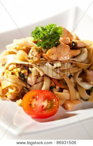 Japanese Cuisine - Udon with Salmon and Vegetables. Garnished with Cherry Tomato