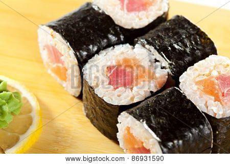 Japanese Cuisine - Sushi Roll with Salmon and Tuna inside. Nori outside