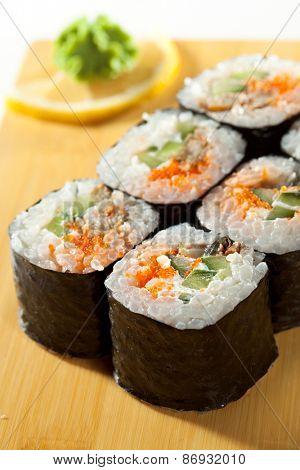 Japanese Cuisine - Sushi Roll with Eel, Cucumber and Masago inside. Nori outside