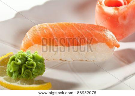 Japanese Cuisine -  Smoked Salmon Nigiri Sushi with Ginger and Wasabi
