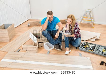 Contemplated Couple With Disassembled Furniture