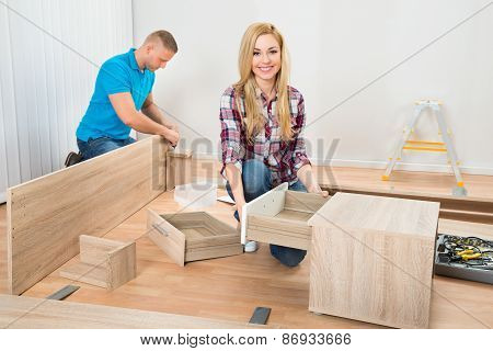Couple Assembling Wooden Furniture