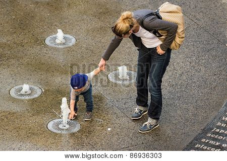 Child Playing In The Fountains