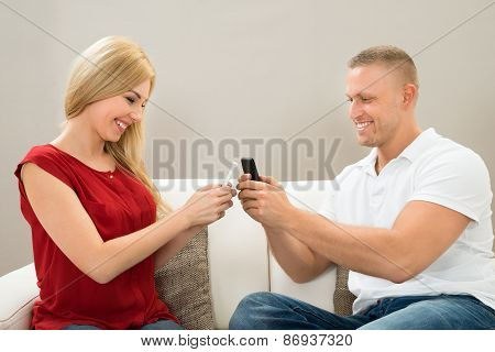 Couple Chatting With Mobile Phone