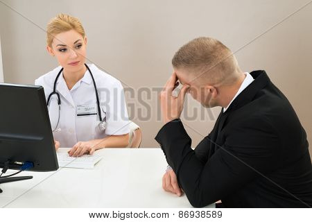 Female Doctor Looking At Patient
