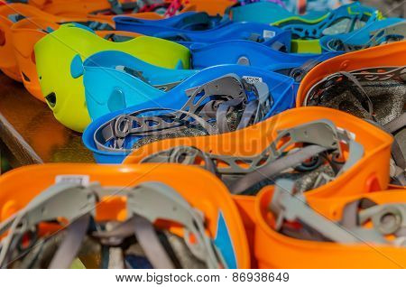 Saftey Helmets In Different Colors Into An Adventure Park