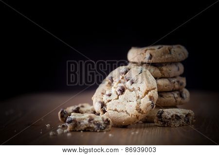Stack Of Chocolate Chip Cookies On Wooden Table. Shallow Dof. Focus On The Front Cookie