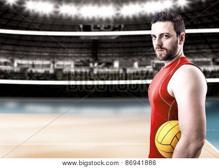 Volleyball player on red uniform on volleyball court