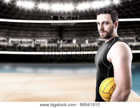 Volleyball player on black uniform on volleyball court