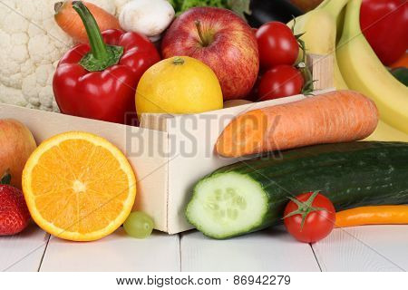 Fruits And Vegetables Like Oranges, Apple In Wooden Box