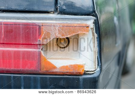 Old Car With Broken Car Tail Light