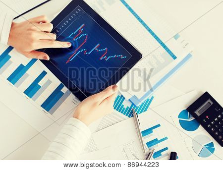 business, office, school and money concept - woman with chart paper, tablet pc and forex chart in it
