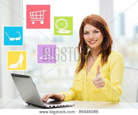 fashion, sale, people and technology concept - smiling woman with laptop computer shopping online and showing thumbs up at home