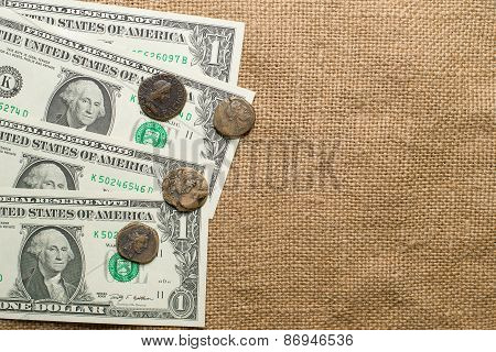 Antique  Coins With Portraits Of Emperors And Banknote  On Old Cloth