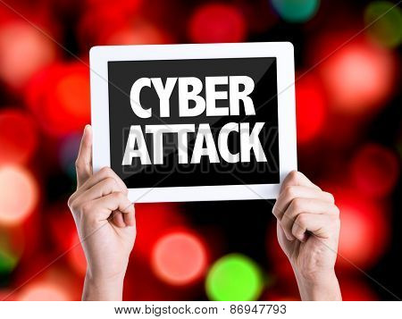 Tablet pc with text Cyber Attack with bokeh background