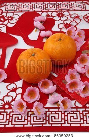mandarin oranges on the red paper cutting