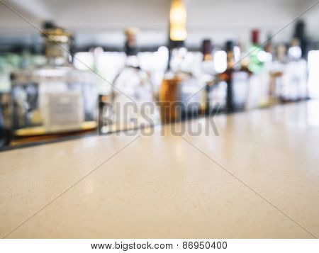 Top Of Counter Bar With Blurred Beer Bottle Restaurant Interior