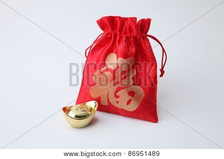 lucky bag with ingot by the side
