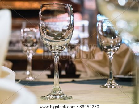 Empty Glasses In Restaurant, Dining Table Set With Blurred Interior Background