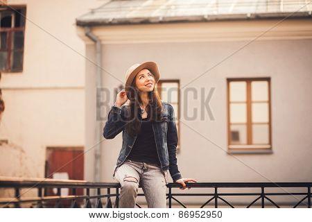 Pretty Girl Sitting On The Railing