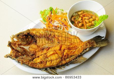 deep fried sea bass with spicy house sauce