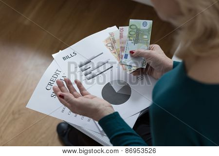 Woman Paying Off The Loan