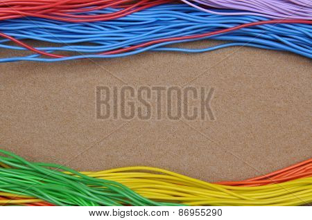 Color cables on brown felt