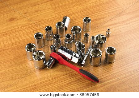 Ratchet And A Set Of Different Attachments To Tighten The Bolts