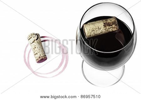 A wine glass, a cork and a wine imprint on a white background