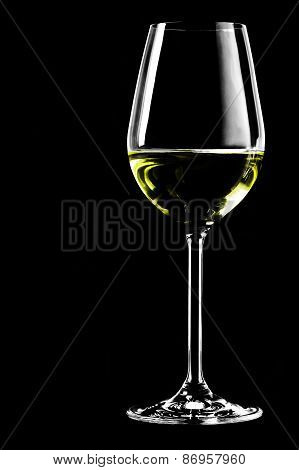 A wine glass on a black background in the vertical format