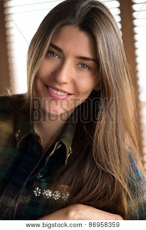 Beautiful Young Lady Relaxing By Window