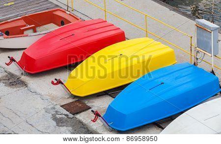 Colorful Plastic Boats Lay On The Pier, Black Sea Coast