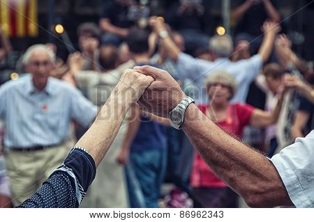 Senior People Holding Hands And Dancing