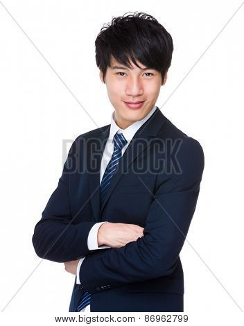 Asian businessman with his arms crossed