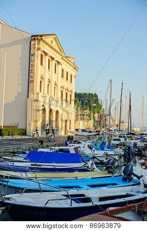 PIRAN, SLOVENIA - 19 JULY 2013: beautiful summer city and port view with boats in Piran, Slovenia
