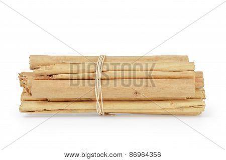 tied true ceylon cinnamon sticks, isolated