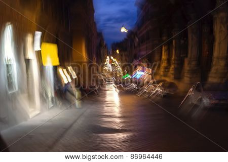 Night traffic in the old part of Rome city in Italy